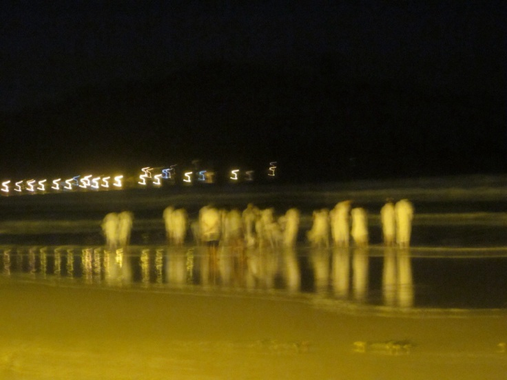 Beach ghosts at the Luau. We had no idea what they were doing. Florianopolis, Brazil, 2014