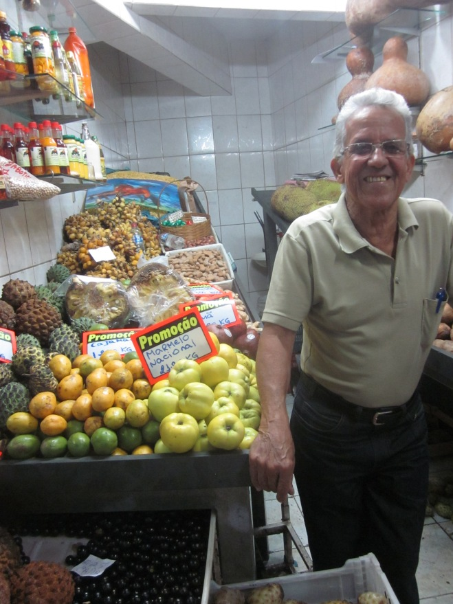 I ate my Broa do Quejo before I took a picture, but here is a cute fruit seller instead! Belo Horizonte, Brazil, Mar 2014